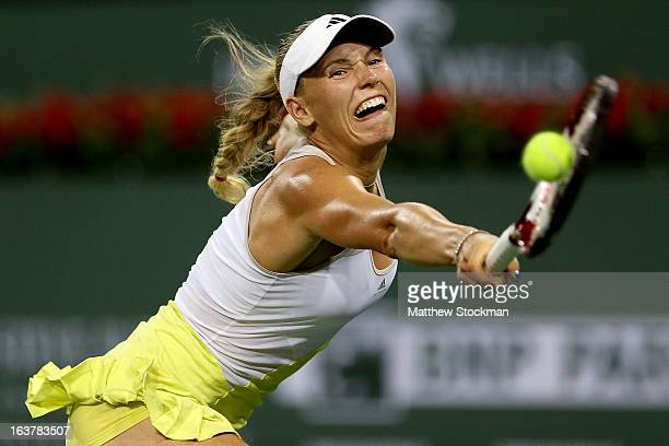 Caroline Wozniacki of Denmark lunges for a shot while playing Angelique Kerber during the BNP Paribas Open at the Indian Wells Tennis Garden on March...