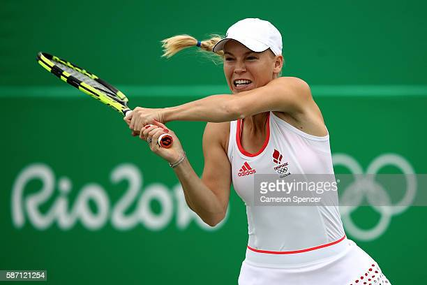 Caroline Wozniacki of Denmark plays a backhand against Lucie Hradecka of Czech Republic in their first round match on Day 2 of the Rio 2016 Olympic...