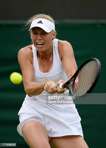 Caroline Wozniacki of Denmark plays a backhand during her Ladies' Singles second round match against Petra Cetkovska of Czech Republic on day three...
