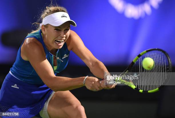 Caroline Wozniacki of Denmark plays a backhand during her quarter final match against Catherine Bellis of United States on day five of the WTA Dubai...