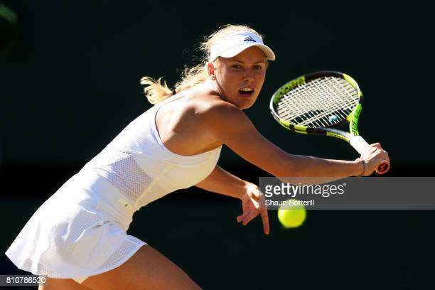 Caroline Wozniacki of Denmark plays a backhand during the Ladies Singles third round match against Anett Kontaveit of Estonia on day six of the...