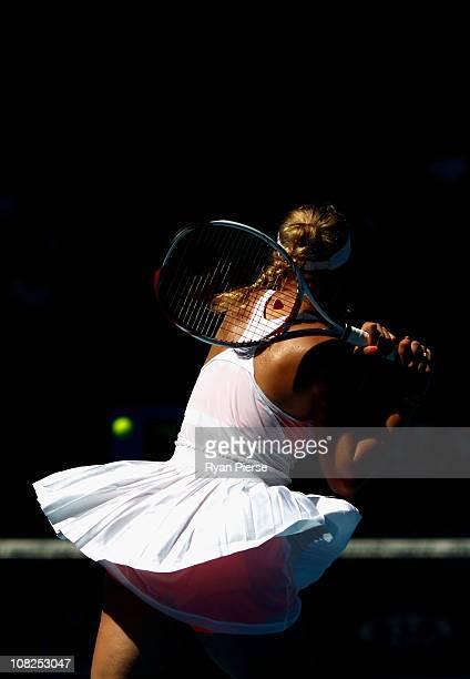 Caroline Wozniacki of Denmark plays a backhand in her fourth round match against Anastasija Sevastova of Latvia during day seven of the 2011...
