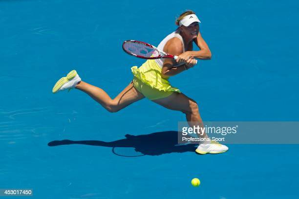 Caroline Wozniacki of Denmark plays a backhand in her fourth round match against Svetlana Kuznetsova of Russia during day eight of the 2013...
