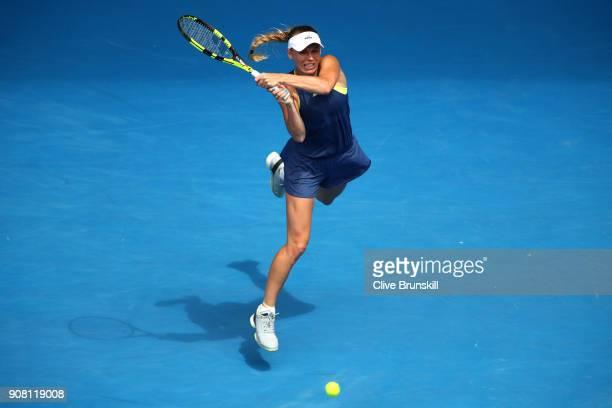 Caroline Wozniacki of Denmark plays a backhand in her fourth round match against Magdalena Rybarikova of Slovakia on day seven of the 2018 Australian...
