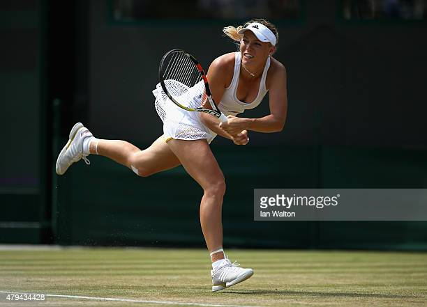 Caroline Wozniacki of Denmark plays a backhand in her Ladies' Singles Third Round match against Camila Giorgi of Italy during day six of the...