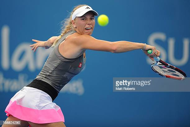 Caroline Wozniacki of Denmark plays a backhand in her match against Ksenia Pervak of Kazakhstan during day two of the Brisbane International at Pat...