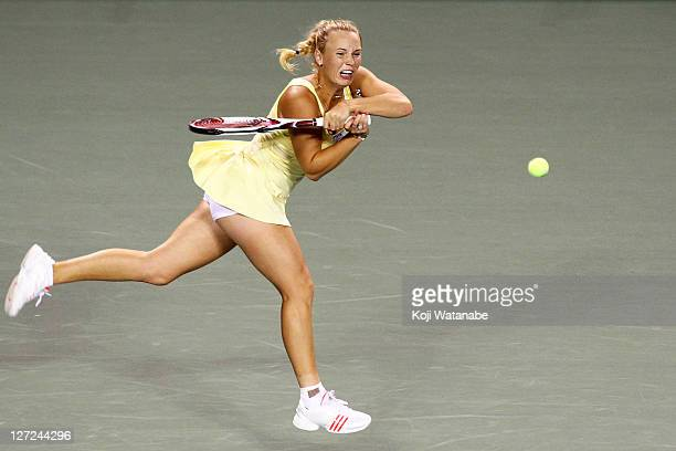 Caroline Wozniacki of Denmark plays a backhand in her match Jarmila Gajdosova of Australia against during the day three of the Toray Pan Pacific Open...