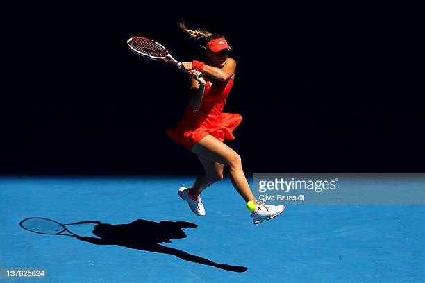 Caroline Wozniacki of Denmark plays a backhand in her quarter final match against Kim Clijsters of Belgium during day nine of the 2012 Australian...