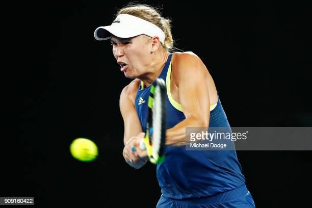 Caroline Wozniacki of Denmark plays a backhand in her quarterfinal match against Carla SuarezNavarro of Spain on day nine of the 2018 Australian Open...