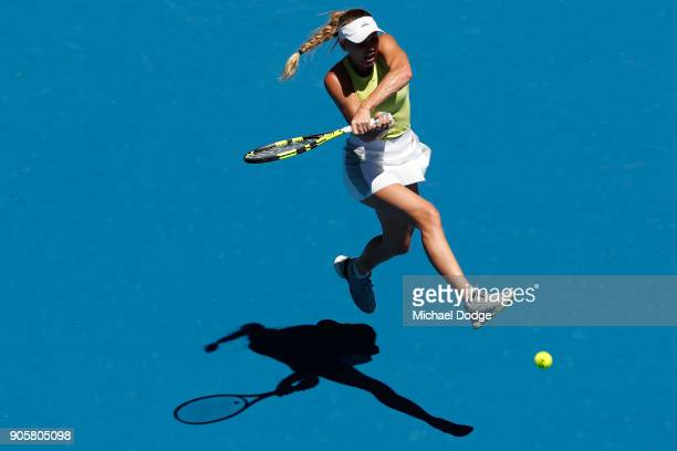 Caroline Wozniacki of Denmark plays a backhand in her second round match against Jana Fett of Croatia on day three of the 2018 Australian Open at...