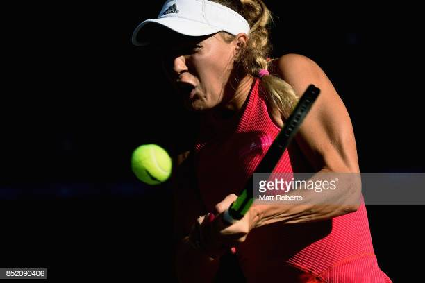 Caroline Wozniacki of Denmark plays a backhand in her semi final match against Garbine Muguruza of Spain during day six of the Toray Pan Pacific Open...