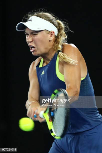 Caroline Wozniacki of Denmark plays a backhand in her third round match against Kiki Bertens of the Netherlands on day five of the 2018 Australian...
