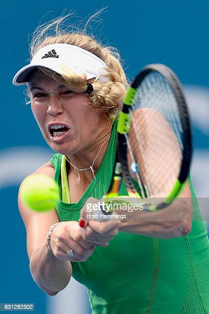 Caroline Wozniacki of Denmark plays a backhand shot in her first round match against Monica Puig of Puerto Rico during day two of the 2017 Sydney...