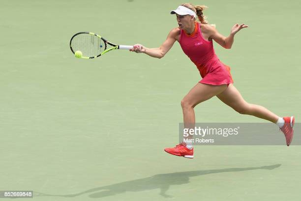 Caroline Wozniacki of Denmark plays a forehand against Anastasia Pavlyuchenkova of Russia during the women's singles final match on day seven of the...