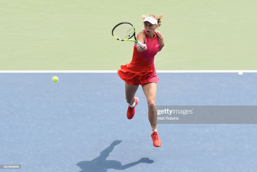Caroline Wozniacki of Denmark plays a forehand against Anastasia Pavlyuchenkova of Russia during the women's singles final match on day seven of the Toray Pan Pacific Open Tennis At Ariake Coliseum on September 24, 2017 in Tokyo, Japan.