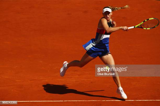 Caroline Wozniacki of Denmark plays a forehand against Daria Gavrilova of Australia during day two of the Mutua Madrid Open tennis tournament at the...