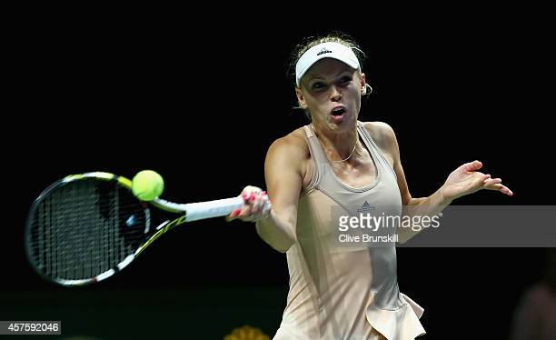 Caroline Wozniacki of Denmark plays a forehand against Maria Sharapova of Russia in their round robin match during the BNP Paribas WTA Finals at...