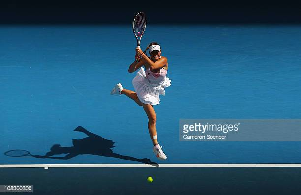 Caroline Wozniacki of Denmark plays a forehand during her quarterfinal match against Francesca Schiavone of Italy during day nine of the 2011...