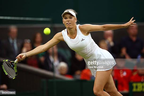 Caroline Wozniacki of Denmark plays a forehand during the Ladies Singles first round match against Svetlana Kuznetsova of Russia on day two of the...