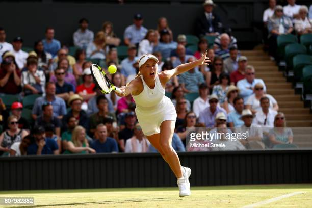 Caroline Wozniacki of Denmark plays a forehand during the Ladies Singles first round match against Timea Babos of Hungary on day two of the Wimbledon...