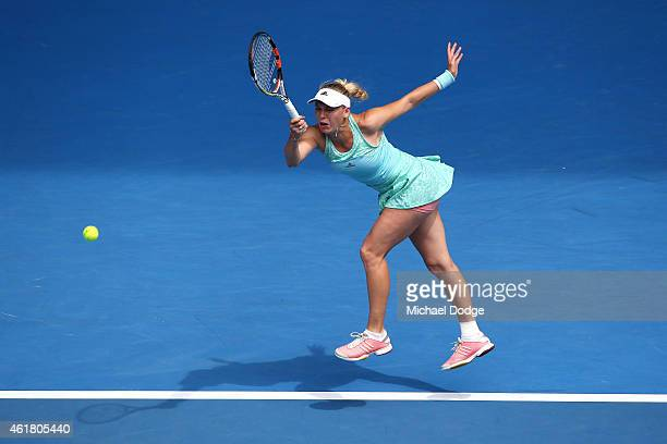 Caroline Wozniacki of Denmark plays a forehand in her first round match against Taylor Townsend of the United States during day two of the 2015...