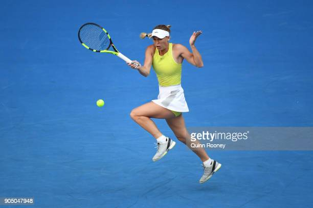 Caroline Wozniacki of Denmark plays a forehand in her first round match against Mihaela Buzarnescu of Romainia on day one of the 2018 Australian Open...