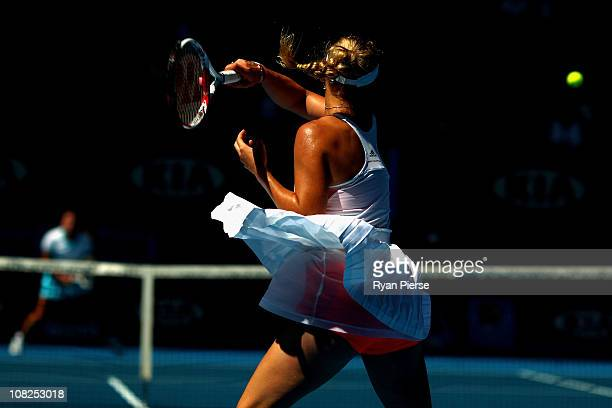 Caroline Wozniacki of Denmark plays a forehand in her fourth round match against Anastasija Sevastova of Latvia during day seven of the 2011...