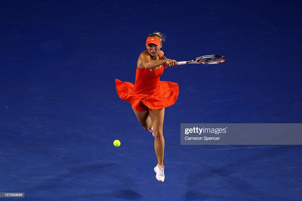 Caroline Wozniacki of Denmark plays a forehand in her fourth round match against Jelena Jankovic of Serbia during day seven of the 2012 Australian Open at Melbourne Park on January 22, 2012 in Melbourne, Australia.
