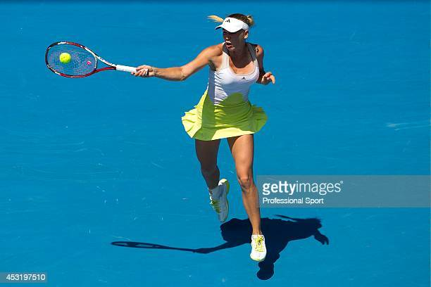 Caroline Wozniacki of Denmark plays a forehand in her fourth round match against Svetlana Kuznetsova of Russia during day eight of the 2013...