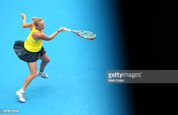 Caroline Wozniacki of Denmark plays a forehand in her match against Dominika Cibulkova of Slovakia during day three of the 2011 Medibank...