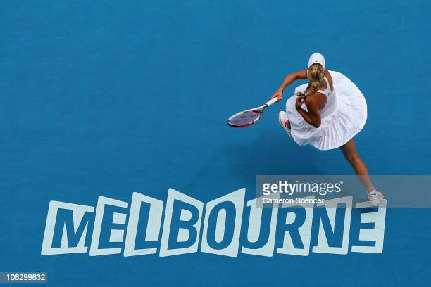 Caroline Wozniacki of Denmark plays a forehand in her quarterfinal match against Francesca Schiavone of Italy during day nine of the 2011 Australian...