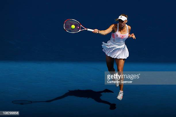 Caroline Wozniacki of Denmark plays a forehand in her quarterfinal match against Francesca Schiavone during day nine of the 2011 Australian Open at...
