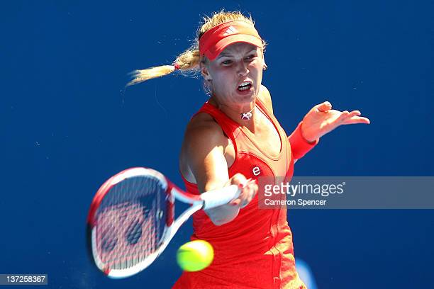 Caroline Wozniacki of Denmark plays a forehand in her second round match against Anna Tatishvili of Georgia during day three of the 2012 Australian...