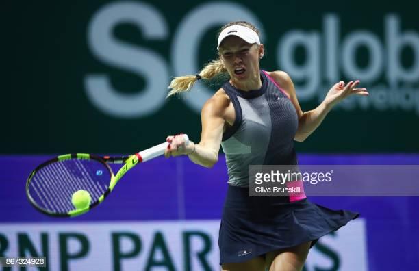 Caroline Wozniacki of Denmark plays a forehand in her singles semi final match against Karolina Pliskova of Czech Republic during day 7 of the BNP...