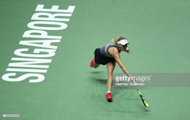 Caroline Wozniacki of Denmark plays a forehand in her singles semi final match against Karolina Pliskova of Czech Republic during day 7 of the BNP...