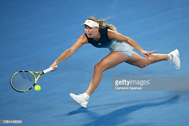 Caroline Wozniacki of Denmark plays a forehand in her third round match against Maria Sharapova of Russia during day five of the 2019 Australian Open...