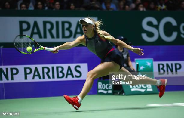 Caroline Wozniacki of Denmark plays a forehand in the Singles Final against Venus Williams of the United States during day 8 of the BNP Paribas WTA...