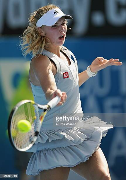 Caroline Wozniacki of Denmark plays a forehand return against Li Na of China at the Sydney International tennis tournament on January 11, 2010....