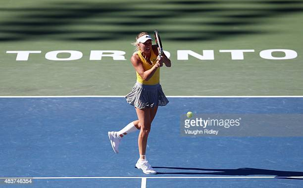 Caroline Wozniacki of Denmark plays a shot against Belinda Bencic of Switzerland during Day 3 of the Rogers Cup at the Aviva Centre on August 12 2015...