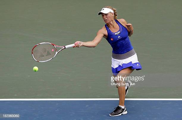 Caroline Wozniacki of Denmark plays a shot against Caroline Garcia of France during day three of the KDB Korea Open at Olympic Park Tennis Stadium on...