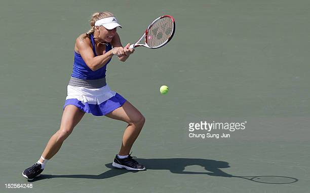 Caroline Wozniacki of Denmark plays a shot against Ekaterina Makarova of Russia during day five of the KDB Korea Open at Olympic Park Tennis Stadium...