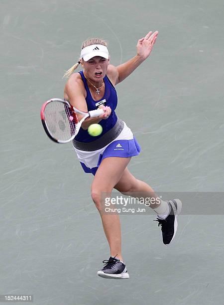 Caroline Wozniacki of Denmark plays a shot against Klara Zakopalova of Czech Republic during day four of the KDB Korea Open at Olympic Park Tennis...
