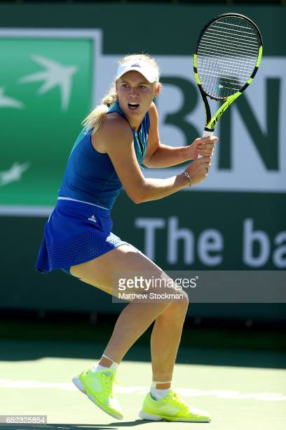 Caroline Wozniacki of Denmark plays Magda Linette of Poland during the BNP Paribas Open at the Indian Wells Tennis Garden on March 11 2017 in Indian...