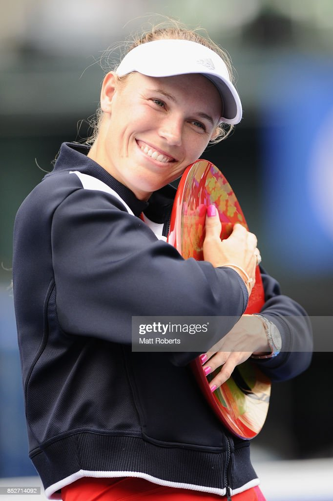 Caroline Wozniacki of Denmark pose with the winners trophy after defeating Anastasia Pavlyuchenkova of Russia in the women's singles final match on day seven of the Toray Pan Pacific Open Tennis At Ariake Coliseum on September 24, 2017 in Tokyo, Japan.