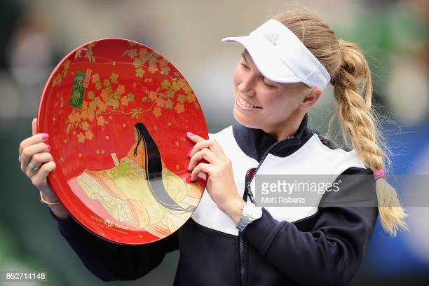 Caroline Wozniacki of Denmark pose with the winners trophy after defeating Anastasia Pavlyuchenkova of Russia in the women's singles final match on...
