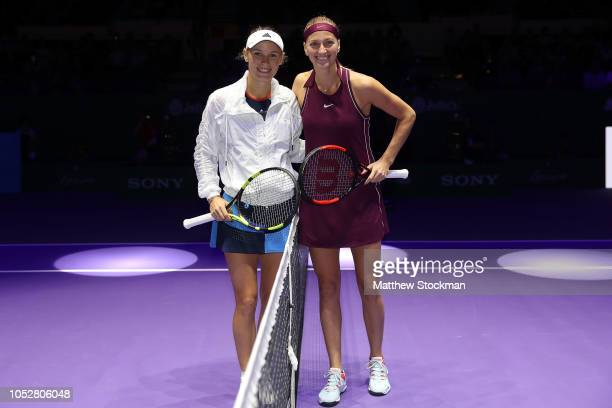 Caroline Wozniacki of Denmark poses for a photo with Petra Kvitova of the Czech Republic prior to their singles match during day 3 of the BNP Paribas...