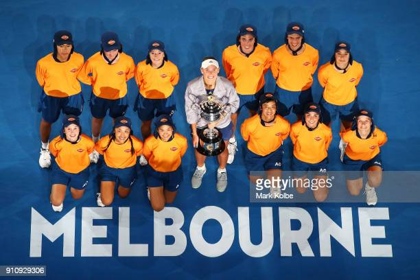 Caroline Wozniacki of Denmark poses for a photo with the ball kids while holding the Daphne Akhurst Memorial Cup after winning the women's singles...