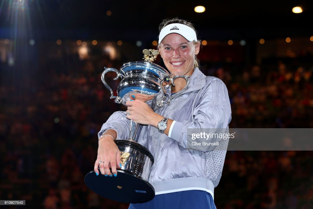 Caroline Wozniacki of Denmark poses for a photo with the Daphne Akhurst Memorial Cup after winning the women's singles final against Simona Halep of Romania on day 13 of the 2018 Australian Open at Melbourne Park on January 27, 2018 in Melbourne, Australia.