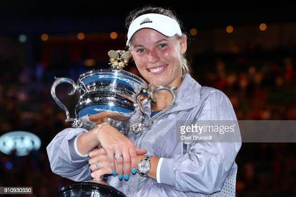 Caroline Wozniacki of Denmark poses for a photo with the Daphne Akhurst Memorial Cup after winning the women's singles final against Simona Halep of...