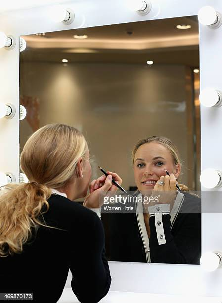 Caroline Wozniacki of Denmark poses for a picture as she attends an Oriflame WTA Strong is Beautiful product launch ahead of day one of the WTA Dubai...